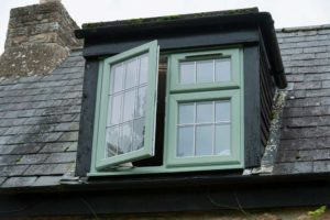 green casement window opening outside