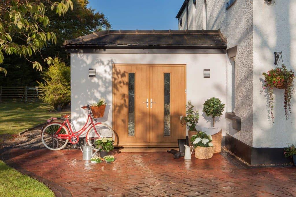 double front doors in an orangey wood
